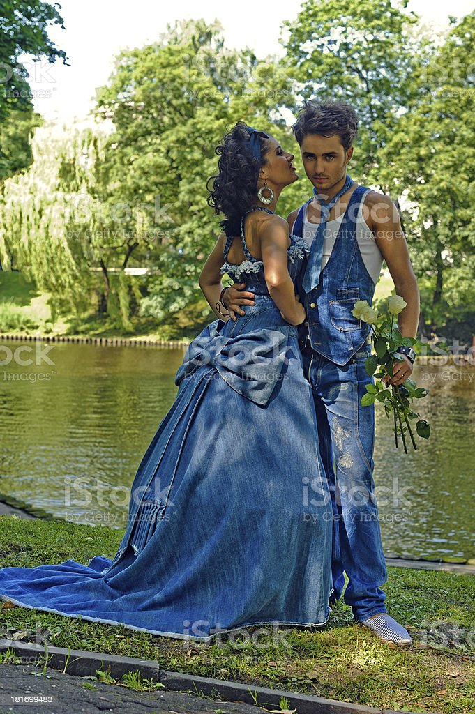Couple in denim suits at the park royalty-free stock photo
