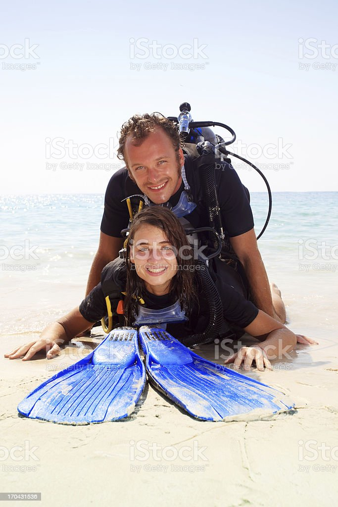 Couple in diving equipment looking at the camera. royalty-free stock photo