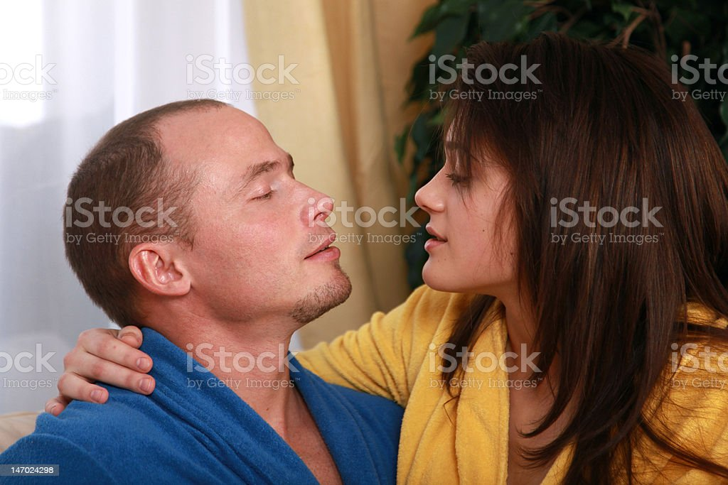 Couple in dressing gowns at home royalty-free stock photo