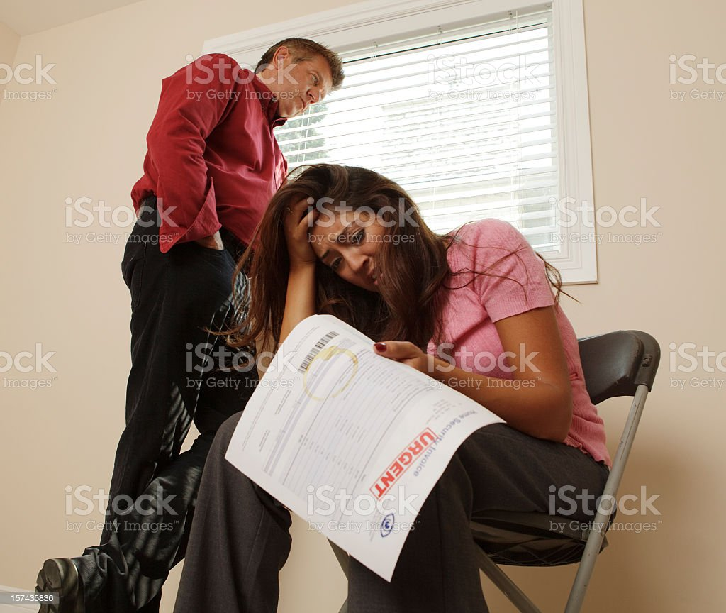 Couple in financial distress worrying about their future royalty-free stock photo