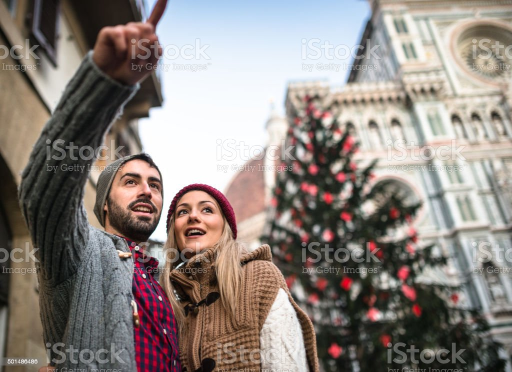 couple in Florence for christmas with christmas tree stock photo