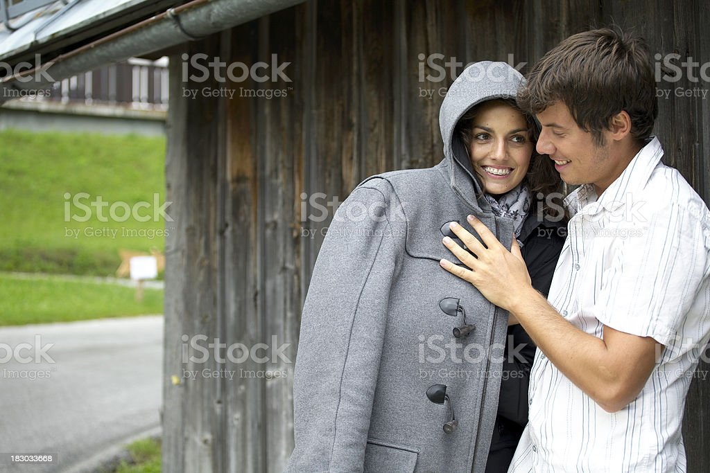 couple in front of house and starting rain royalty-free stock photo