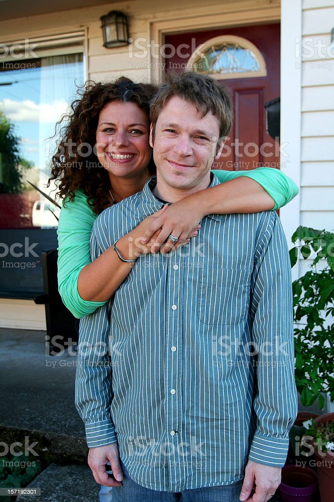 couple in front of house royalty-free stock photo