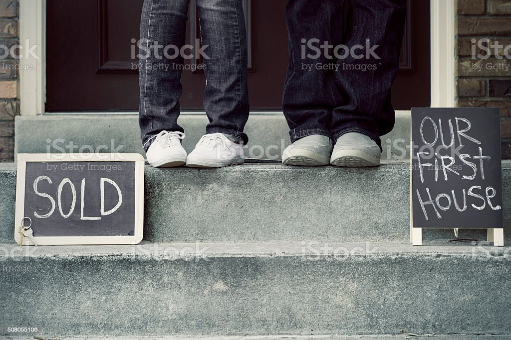 couple in front of new home stock photo