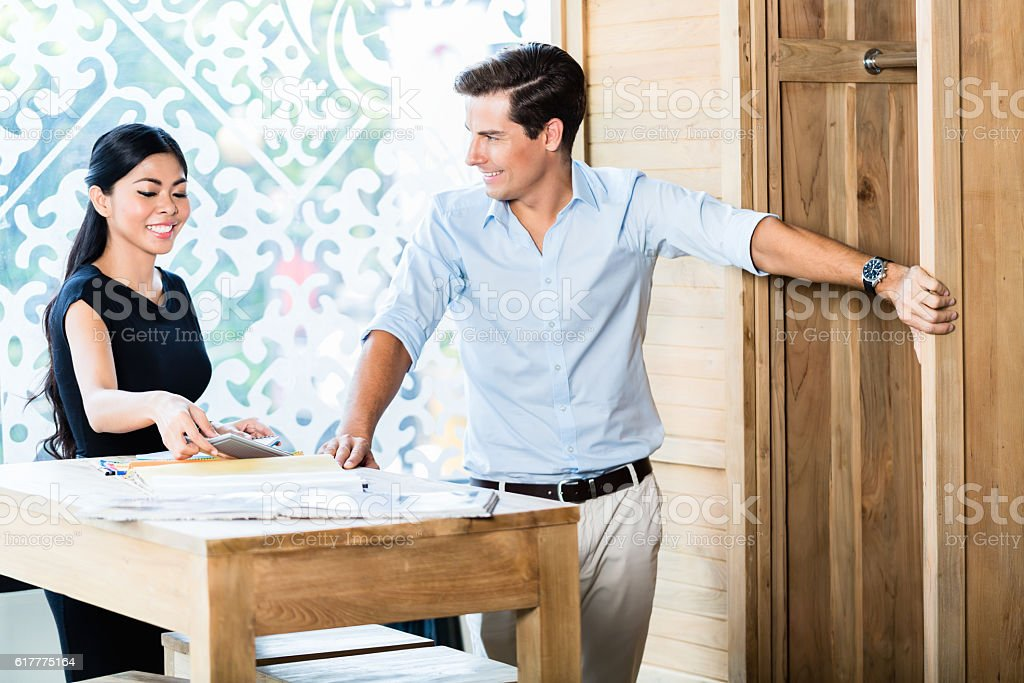 Couple in furniture store checking price stock photo