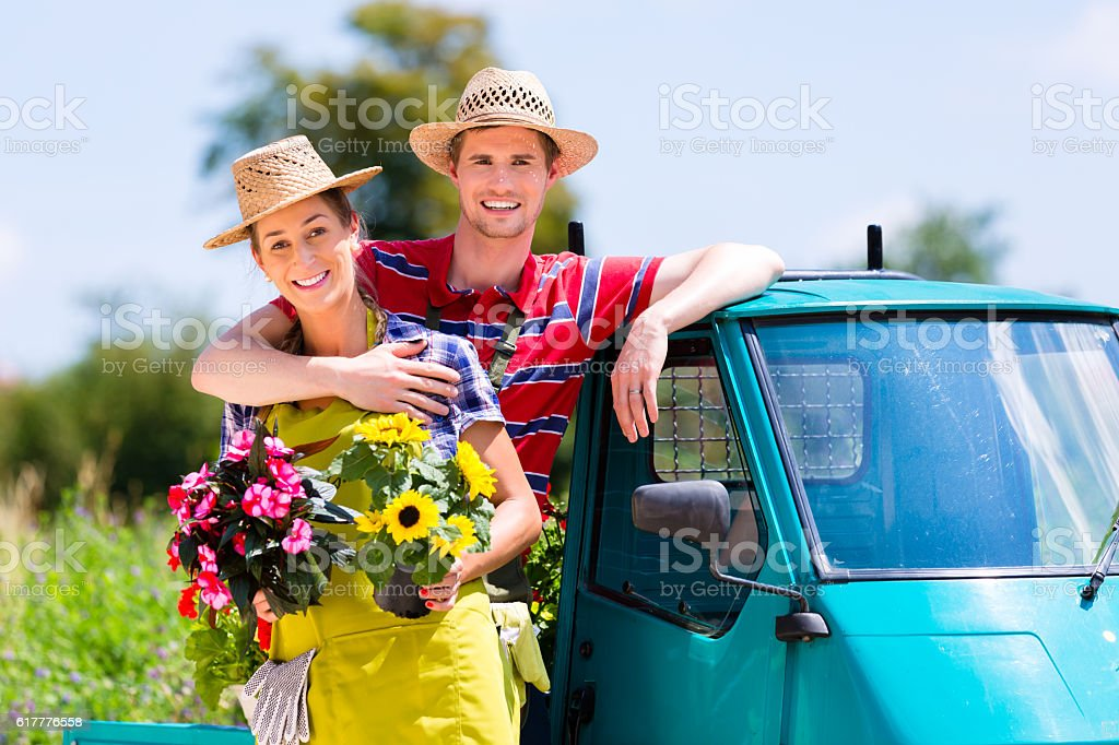 Couple in garden with flowers on gape stock photo