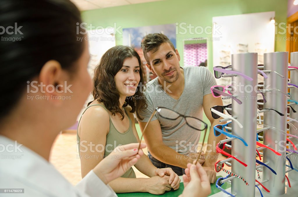 Couple in glasses store stock photo