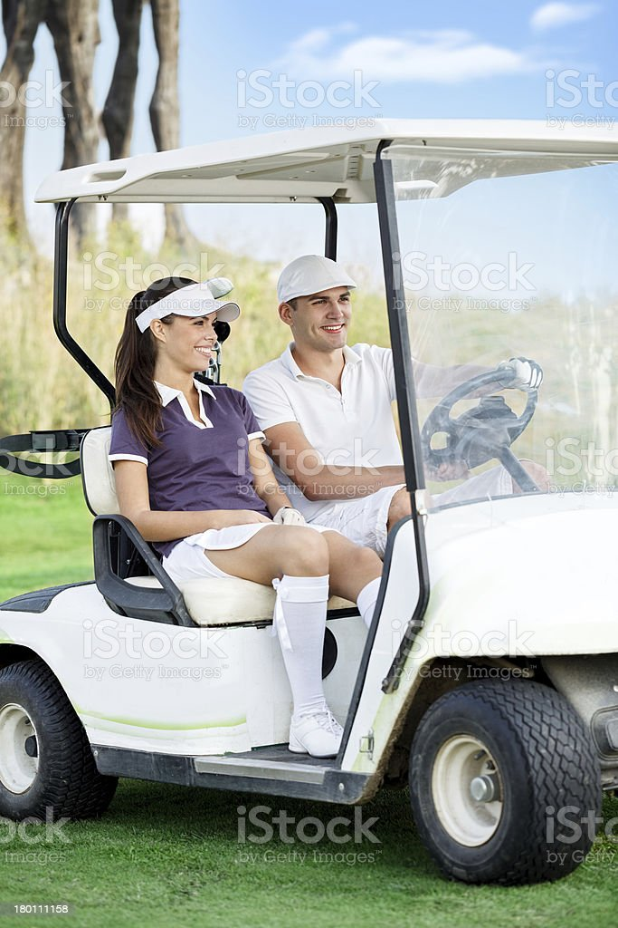 Couple in golf buggy royalty-free stock photo