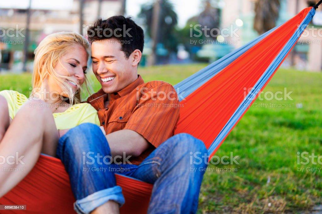 Couple in Hammock stock photo