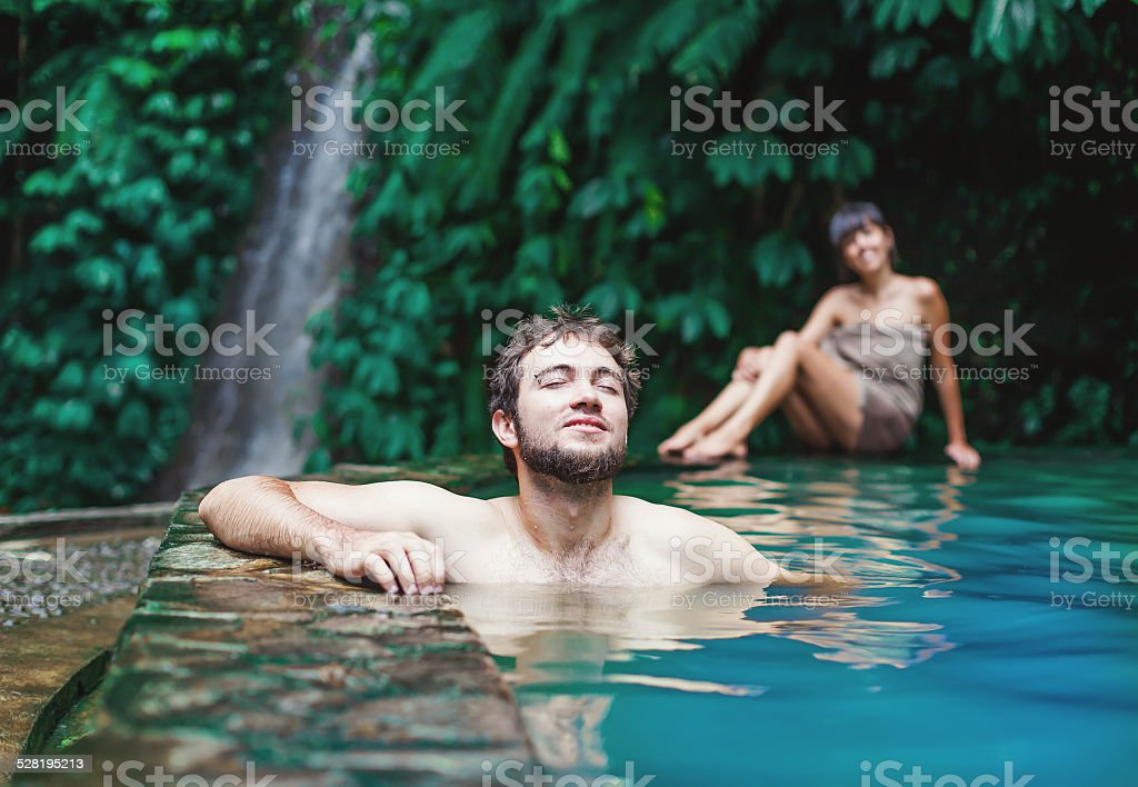 Couple in hot spring stock photo