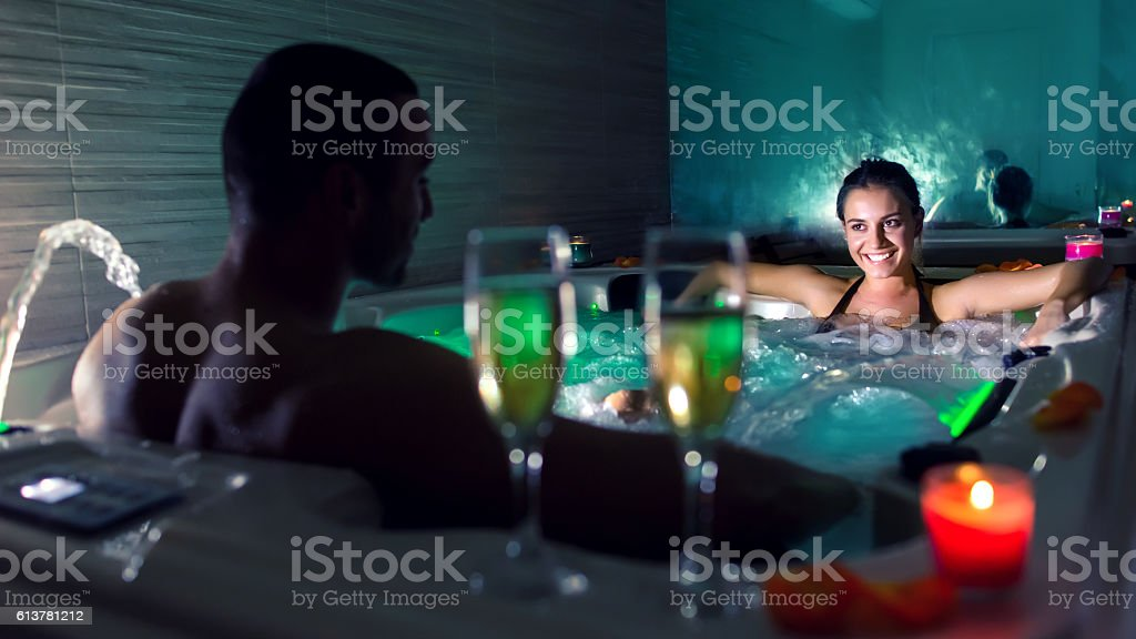 Couple in jacuzzi pool stock photo