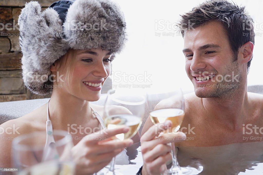 Couple in hot tub with wine stock photo