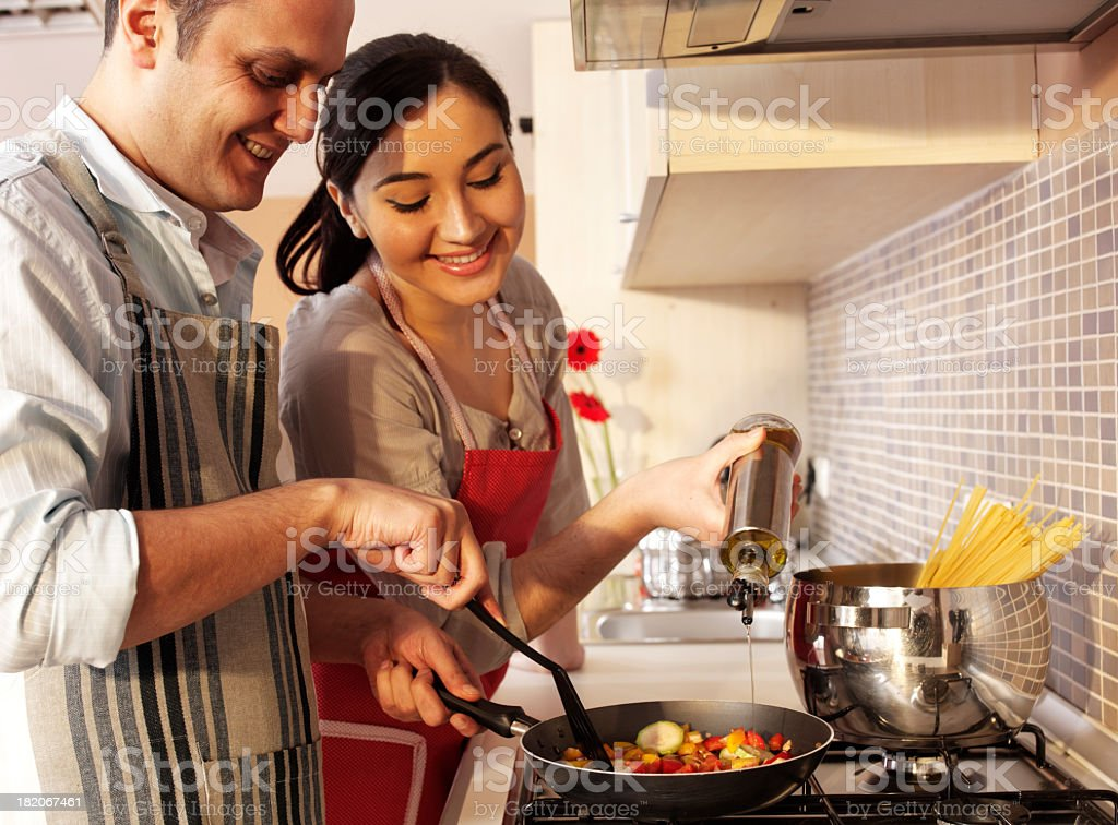couple in kitchen royalty-free stock photo