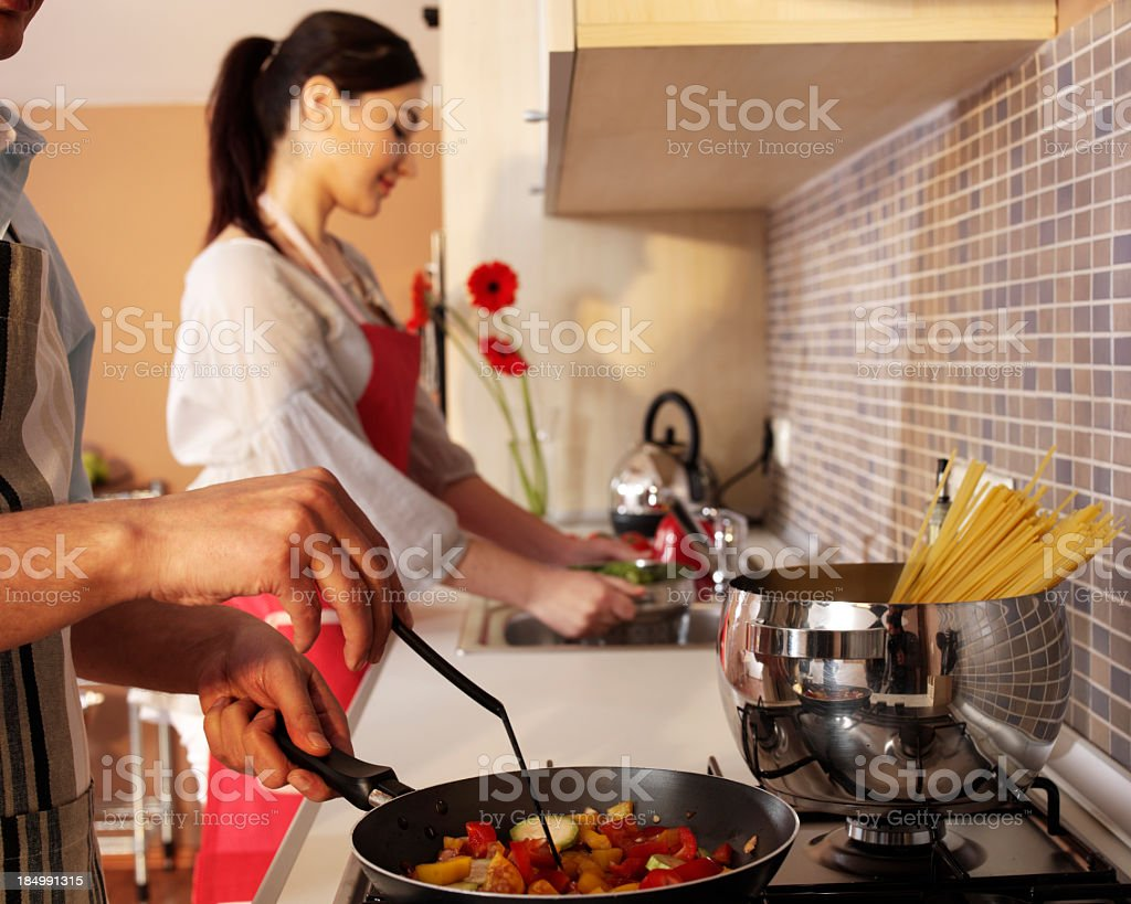 Couple In Kitchen(focus on forground) royalty-free stock photo