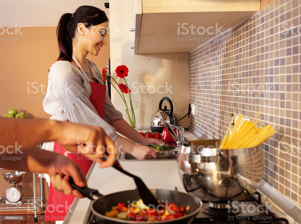 Couple In Kitchen(focus on background) royalty-free stock photo
