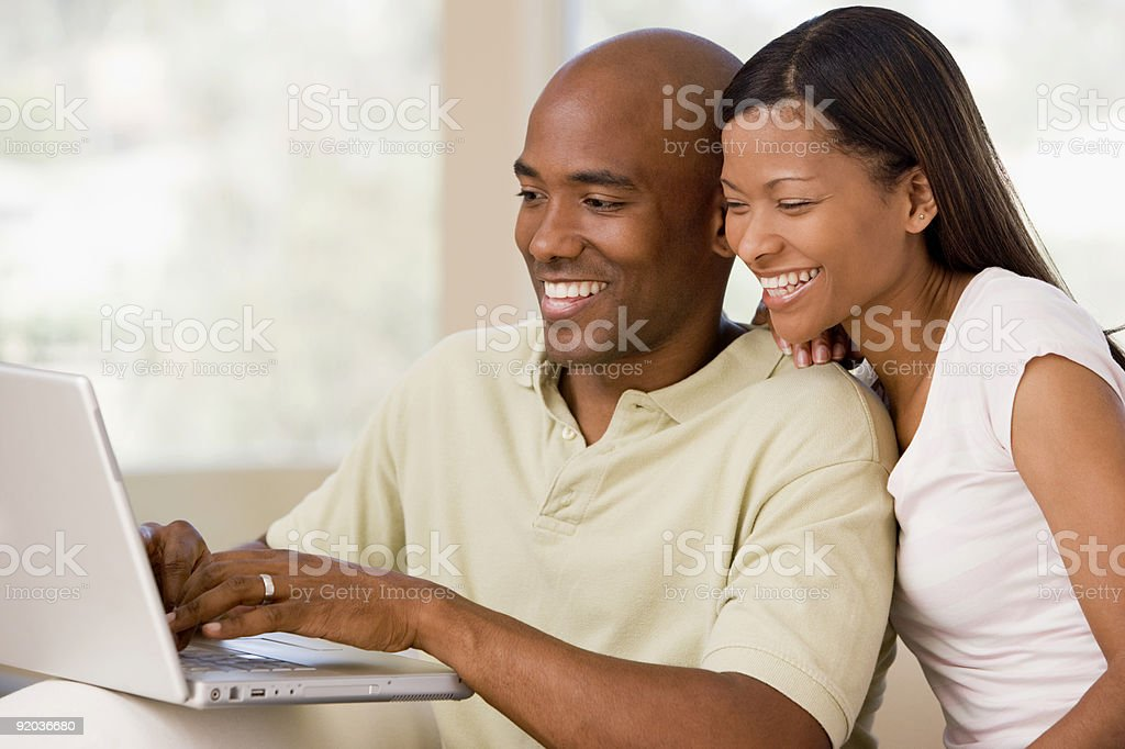 Couple in living room using laptop royalty-free stock photo