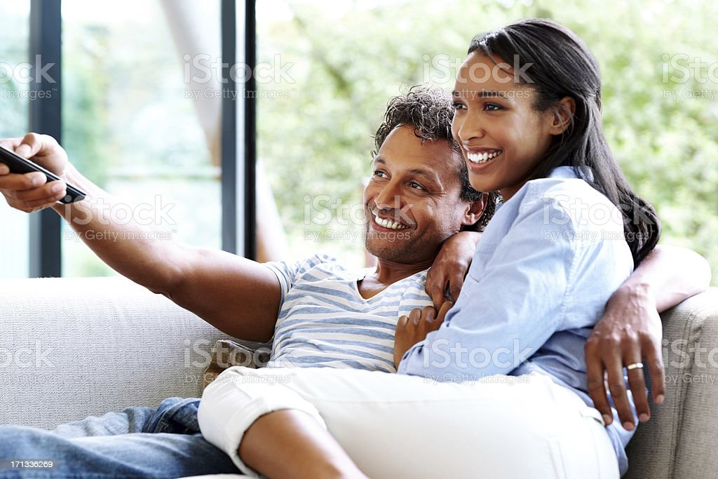 Couple in living room watching television royalty-free stock photo