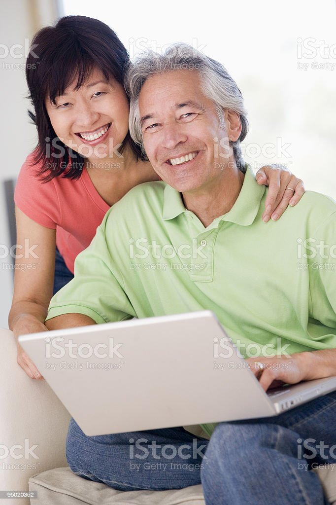 Couple in living room with laptop royalty-free stock photo