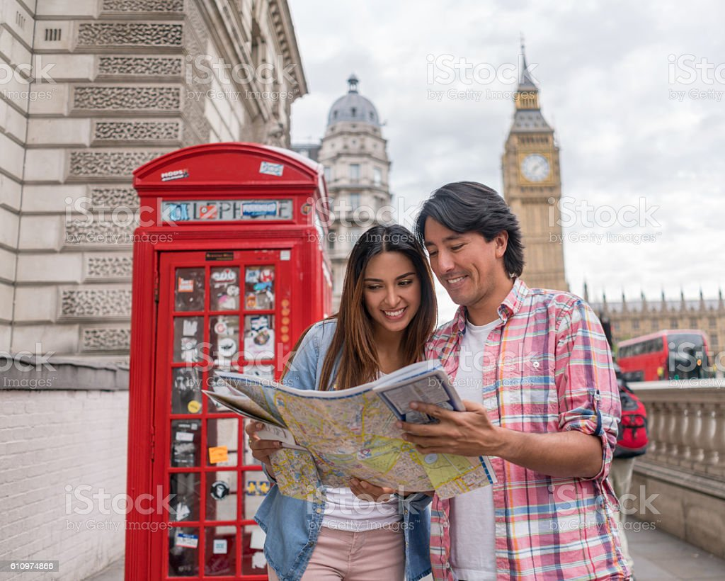 Couple in London looking at a map stock photo