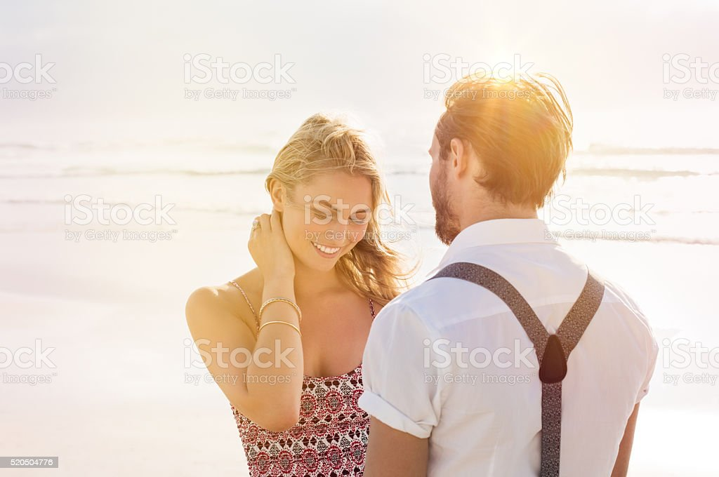 Couple in love at beach stock photo