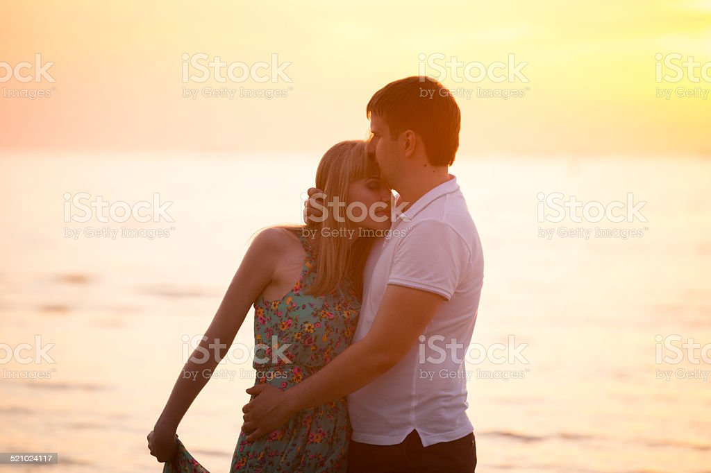 couple in love at sunset royalty-free stock photo