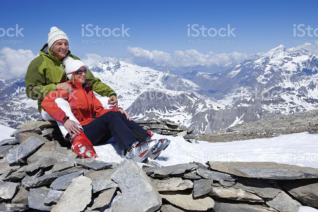 Couple in love at the top of a Mountain royalty-free stock photo