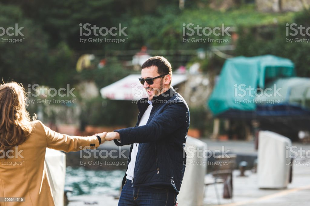 Couple in love dancing on the street stock photo