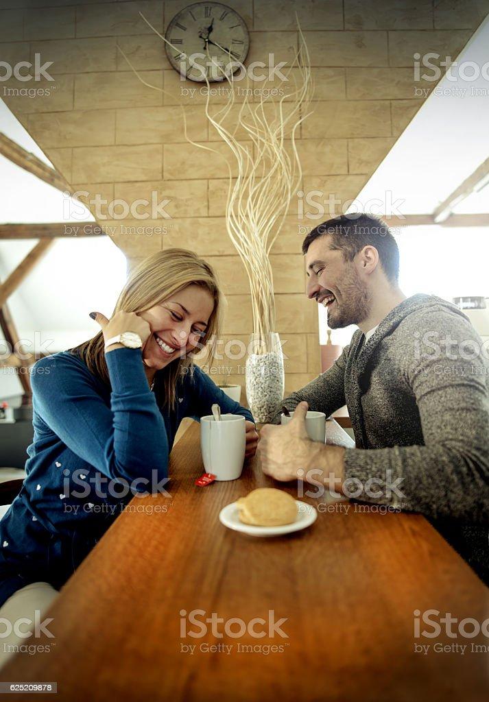 Couple in love drinking tea in coffee shop stock photo