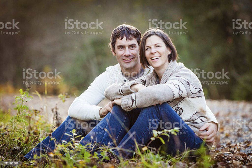 Couple in love enjoying autumn walk. royalty-free stock photo