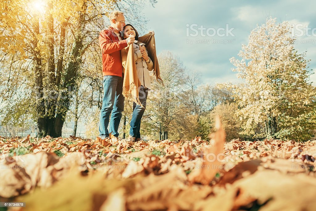 Couple in love have a romantic time in autumn park stock photo