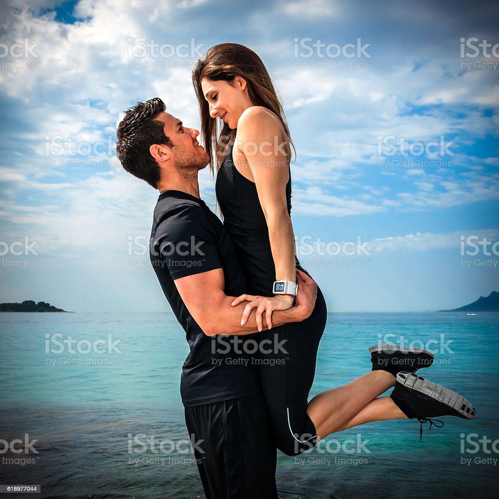 Couple in love having fun on the beach stock photo