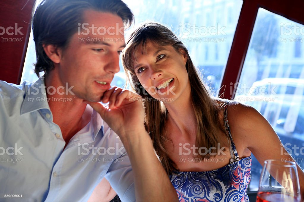 couple in love in a restaurant stock photo