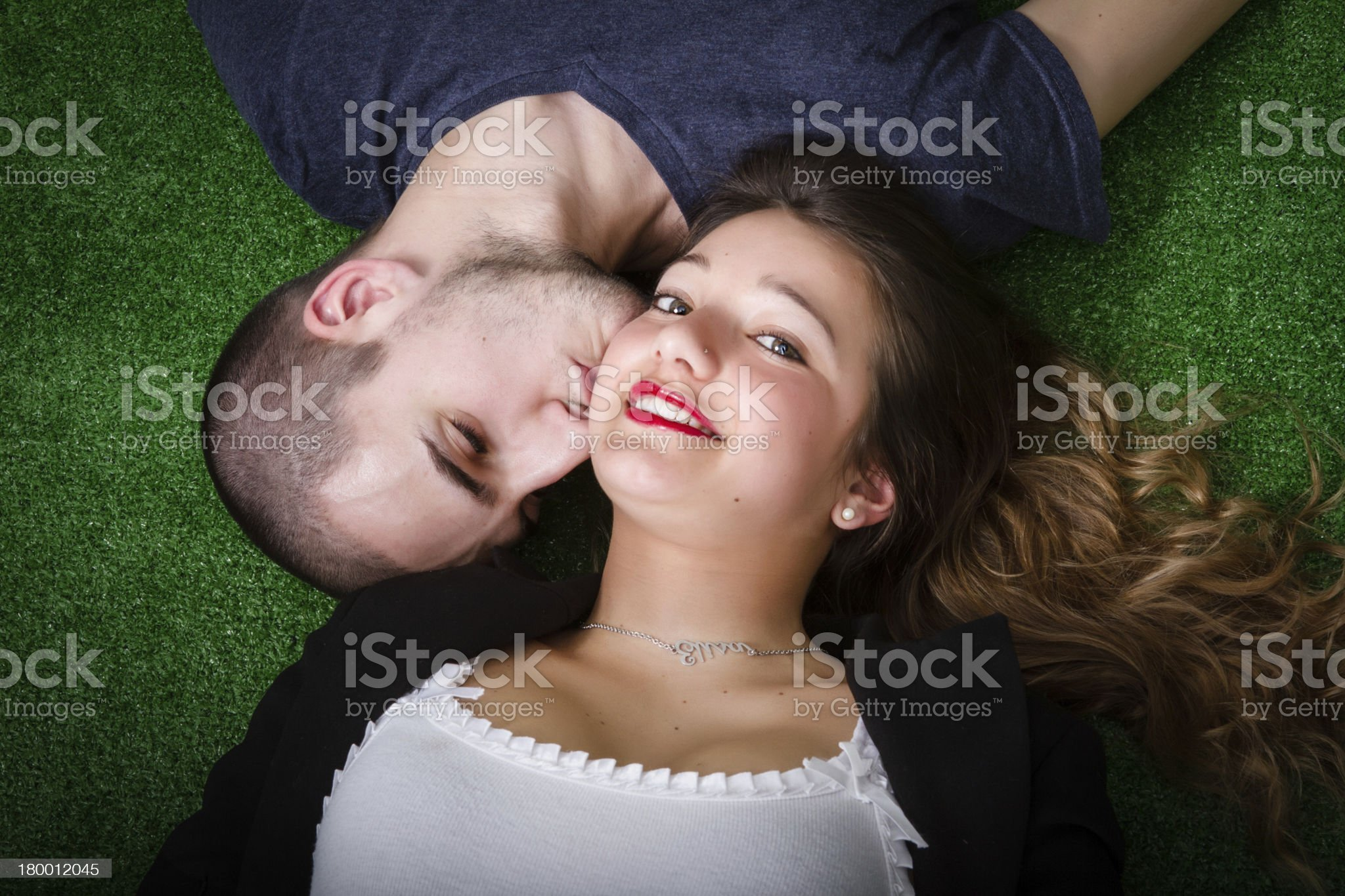couple in love kissing on green grass royalty-free stock photo