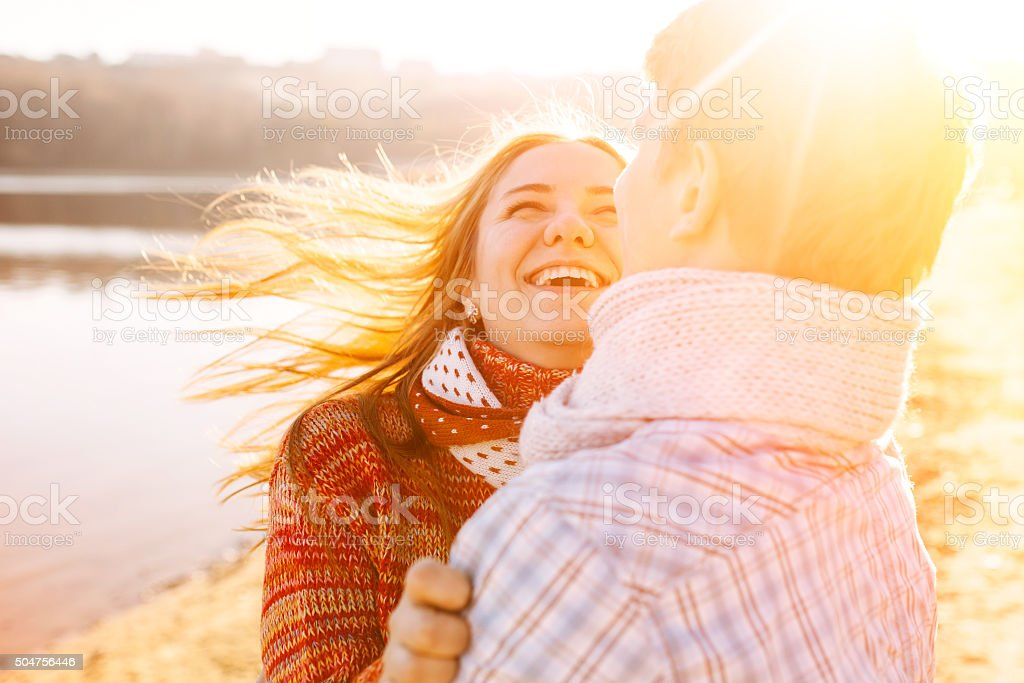 Couple in love laughing stock photo