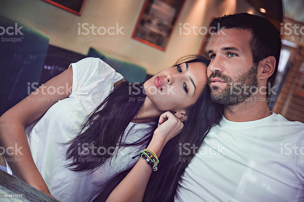 Couple in love looking trough window stock photo
