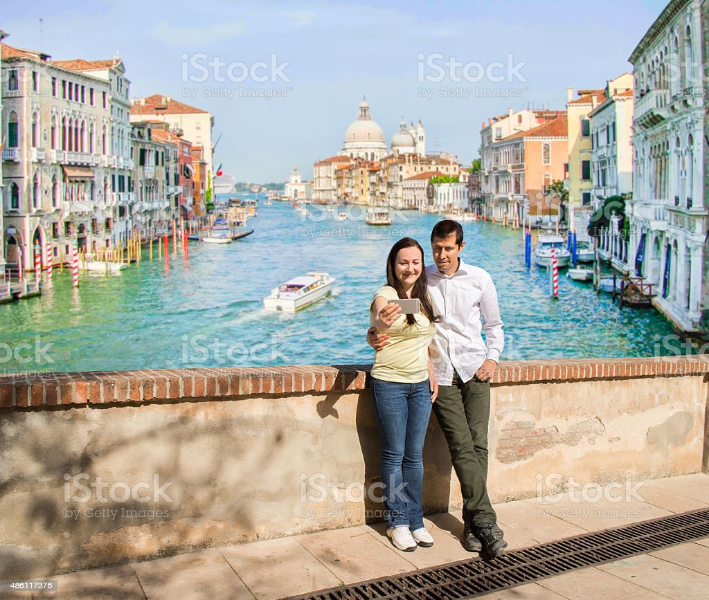 couple in love making the selfie photo in Venice stock photo