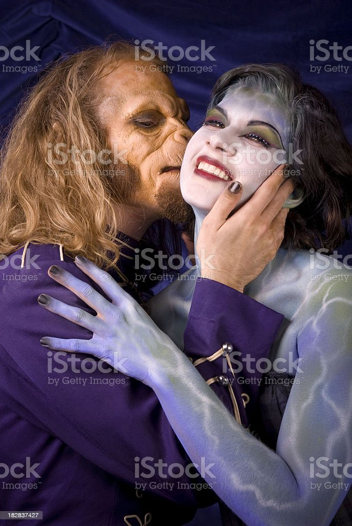 Couple in Love: Monkey Man Embracing, Kissing, Loving Fantasy Woman royalty-free stock photo