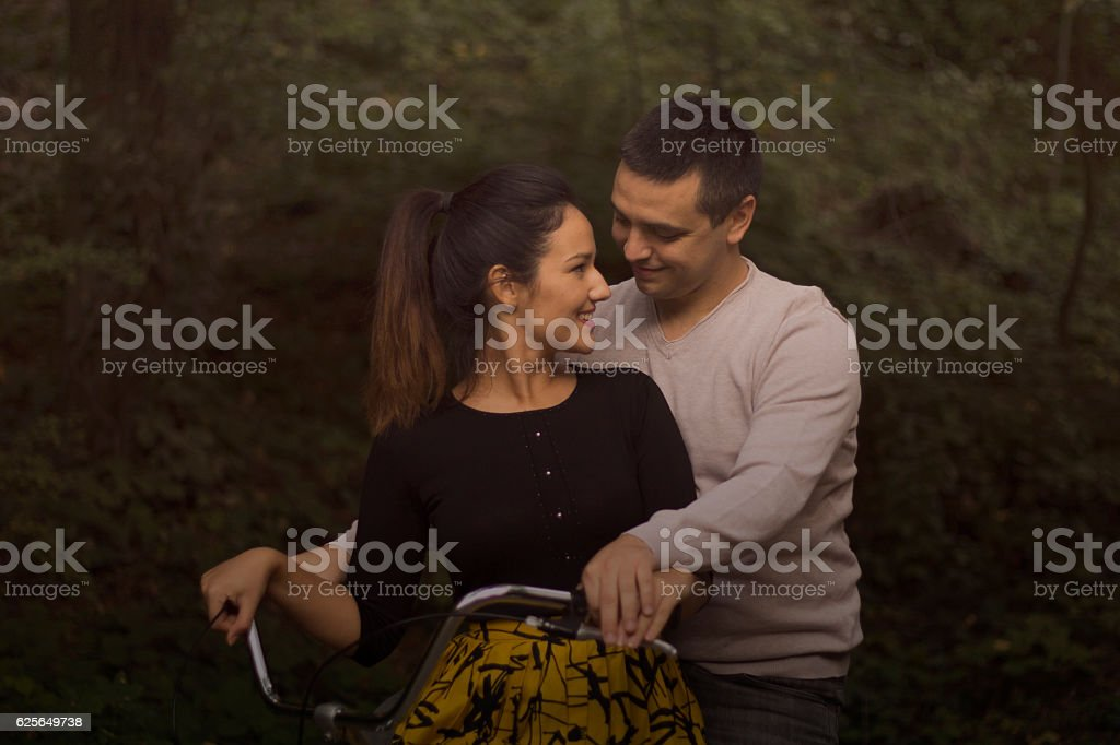 Couple in love on a bicycle stock photo
