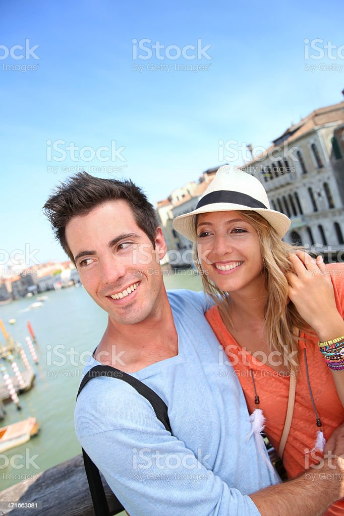 Couple in love over a canal of Venice royalty-free stock photo