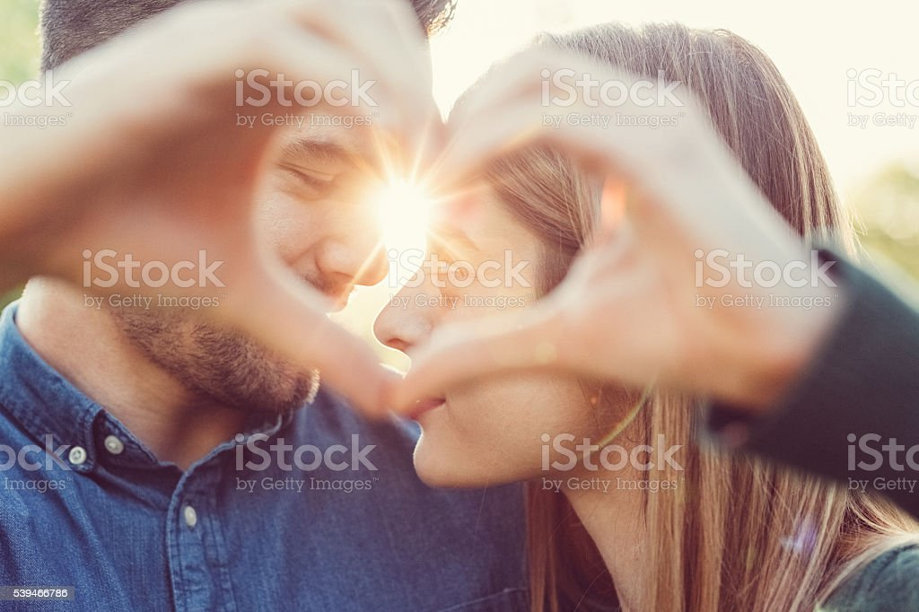 Young People Showing A Heart Shaped Symbol With Hands Stock Images