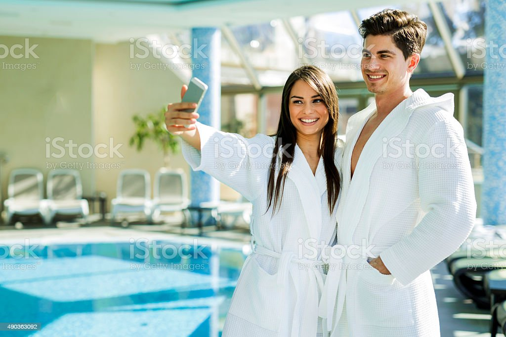 Couple in love standing next to a  pool stock photo