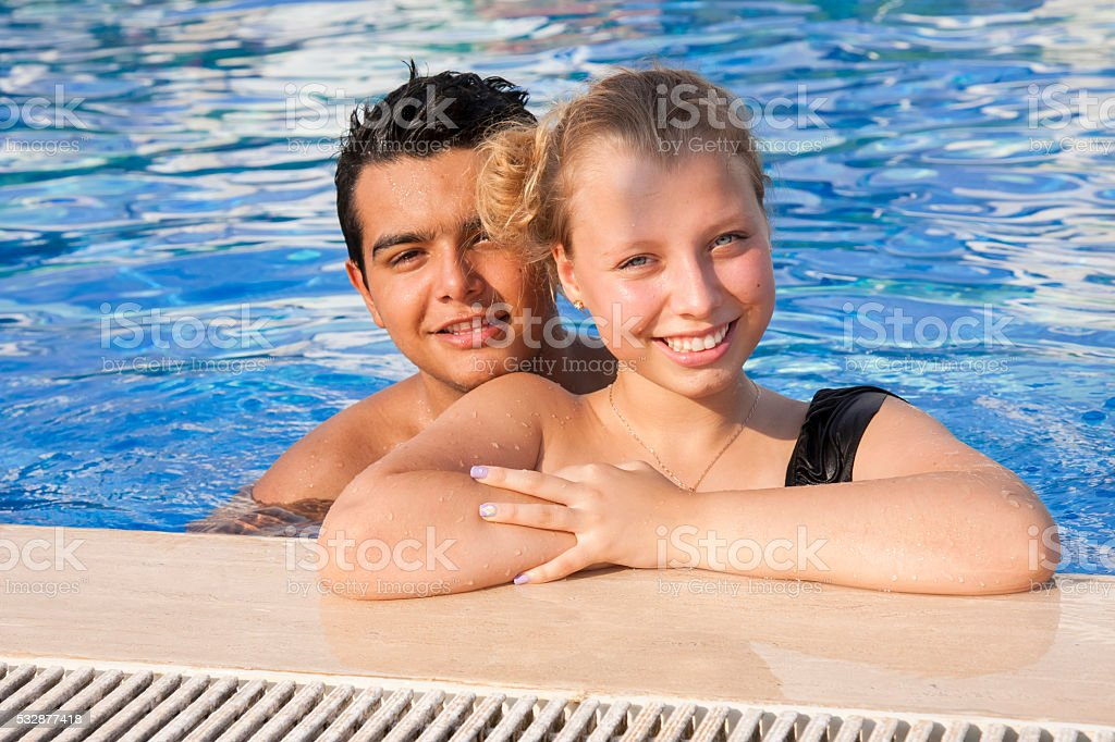 Couple in love swimming in the pool stock photo