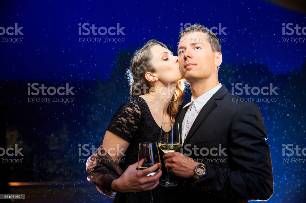 Couple In Love Toasting To Their Love Under The Stars