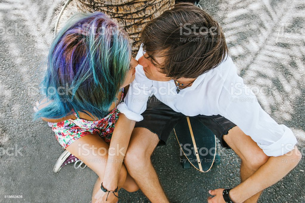 Couple in love under the palm tree stock photo