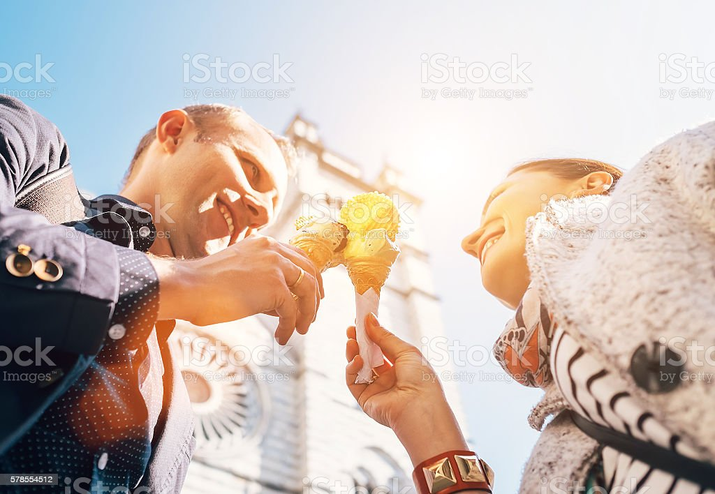 Couple in love with ice-cream with Cathedral background in Genova stock photo