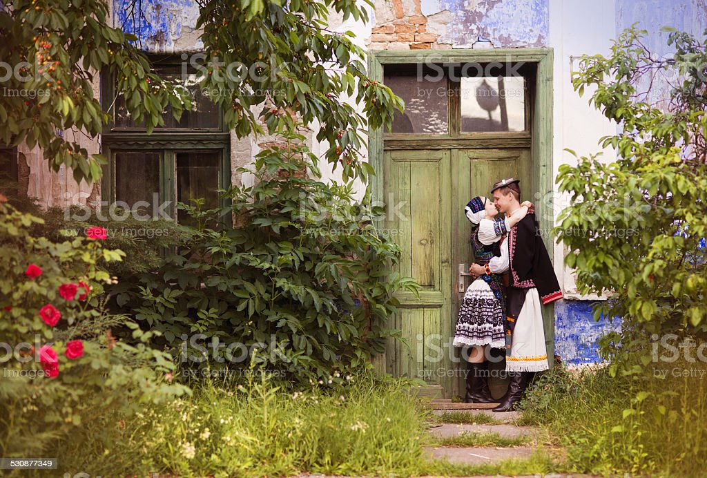Couple in love with national folk costumes stock photo