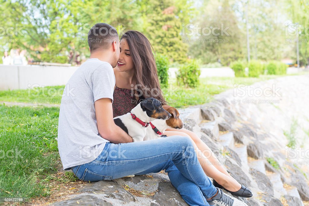 Couple in love,enjoy in park with his dogs stock photo