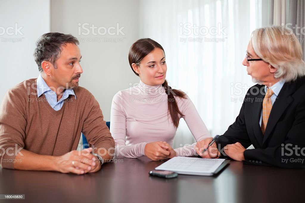Couple in meeting with a financial planner royalty-free stock photo