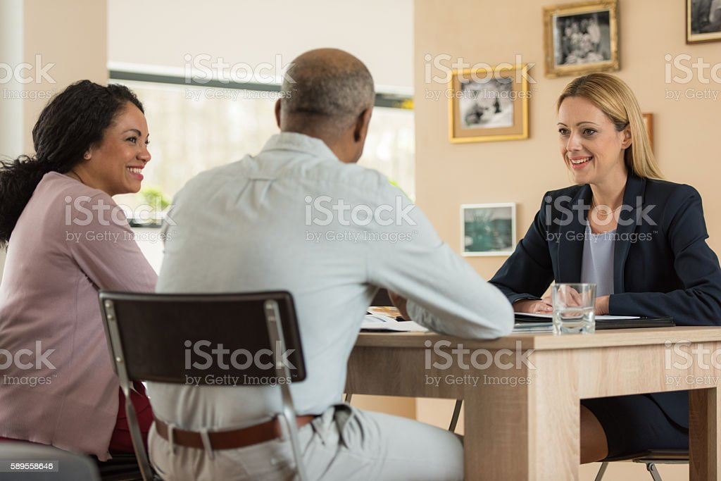 Couple in meeting with financial advisor stock photo