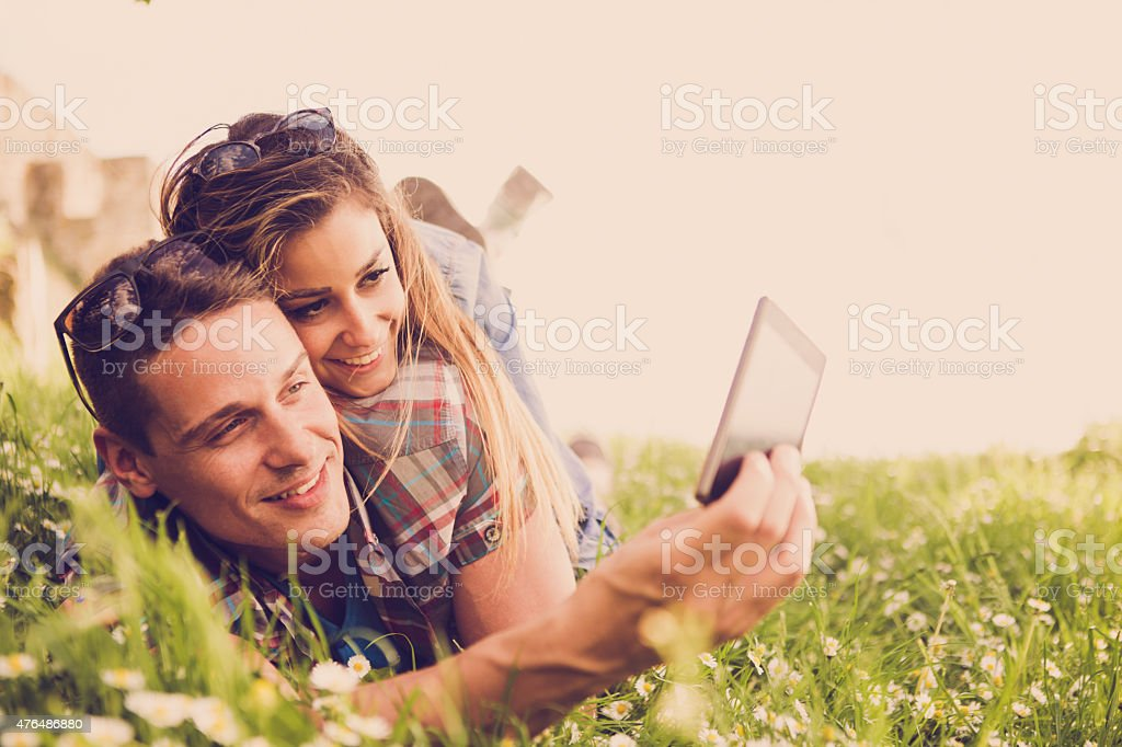 Couple in nature taking selfies stock photo